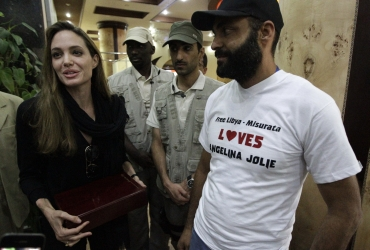 Angelina Jolie receives a plaque from residents at her hotel in Misrata during her visit to the war-torn city