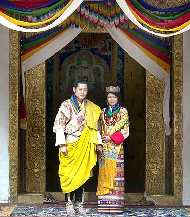 King Jigme Khesar Namgyel Wangchuck and Queen Jetsun Pema pose for pictures after their marriage at the Punkaha Dzong