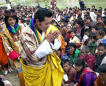 King Jigme Khesar Namgyel Wangchuck and Queen Jetsun Pema greet villagers in Punakha