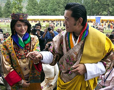 King Jigme Khesar Namgyel Wangchuck holds hands with Queen Jetsun Pema