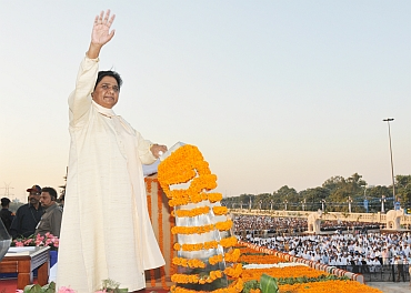 Mayawati waves to crowds after the inaguration of the Dalit memorial in Noida