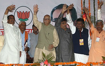 Bhartiya Janta Party's senior leader Lal Krishna Advani with party president Nitin Gadkari