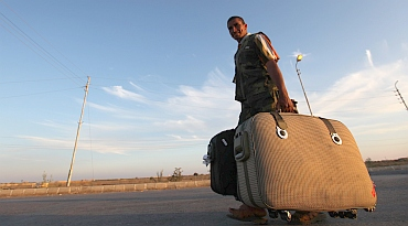 A Palestinian walks past the Rafah border crossing between Egypt and the Gaza Strip, in Rafah city, about 350 km northeast of Cairo