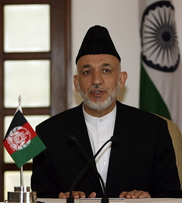 Karzai at a news conference in New Delhi