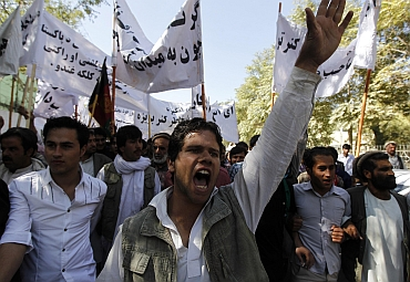 Afghan men shout anti-Pakistan slogans during a demonstration in Kabul