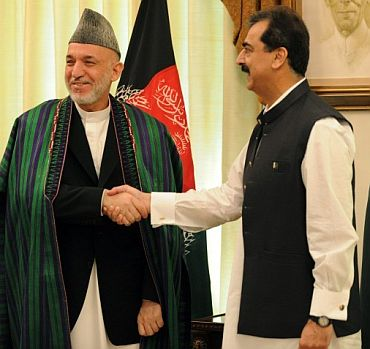 Pakistan PM Gilani with Afghanistan President Hamid Karzai after a meeting in Islamabad