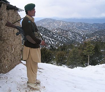 A Pakistani border security force stands guard at a border post along the Pakistan-Afghanistan border in North Waziristan