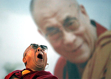 Tibet's exiled spiritual leader the Dalai Lama yawns as he attends a conference