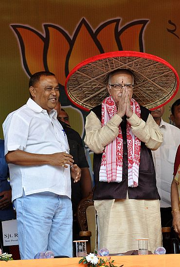 BJP leaders greet Advani on his arrival in Guwahati on Thursday as a part of his country wide Jan Chetna Yatra