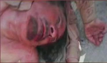 A photograph purporting to show a dead Muammar Gaddafi as show on Libya's Al Ahrar network