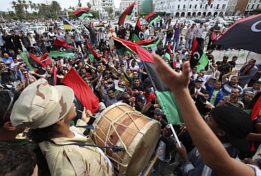 Libyans celebrate at Martyrs square in Tripoli after hearing news of Gaddafi's death