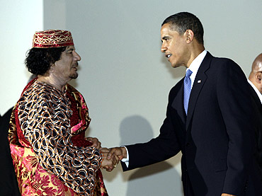 US President Barack Obama shakes hands with Libya's leader Muammar Gaddafi