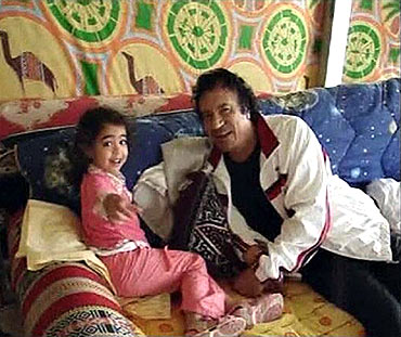 Gaddafi relaxes with his granddaughter in his tent at the Bab al-Aziziya compound in Tripoli