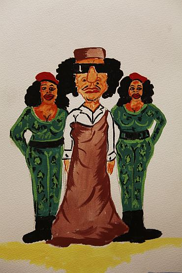 A caricature depicting Libyan leader Muammar Gaddafi (C) with female bodyguards is displayed in a gallery at an exhibition titled Gaddafi's Crimes Exhibition at Old University in Benghazi
