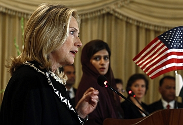 US Secretary of State Hillary Clinton speaks as Pakistan's Foreign Minister Hina Rabbani Khar listens during a joint press availability in Islamabad