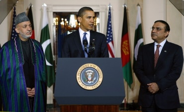 US President Barack Obama talks to reporters as he stands with Afghanistan's President Hamid Karzai and Pakistan's President Asif Ali Zardari in the Grand Foyer of the White House