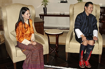 King Jigme Khesar Namgyel Wangchuck and Queen Jetsun Pema sit at the Indira Gandhi international airport