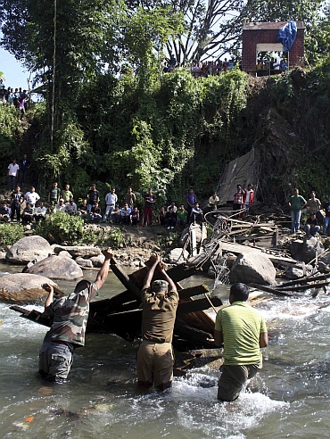 Rescue workers search for bodies at the site of a collapsed bridge at Bijonbari village in Darjeeling district