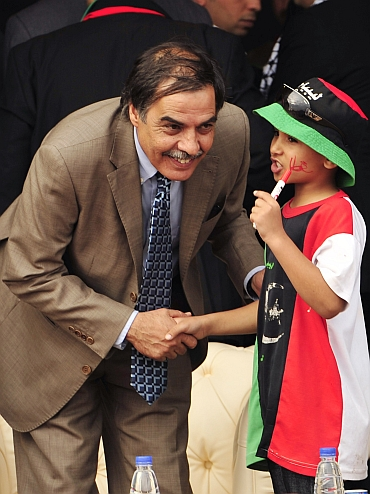 (Left) Ali Tarhouni, Libyan National Transitional Council's minister for oil and finance, in Benghazi