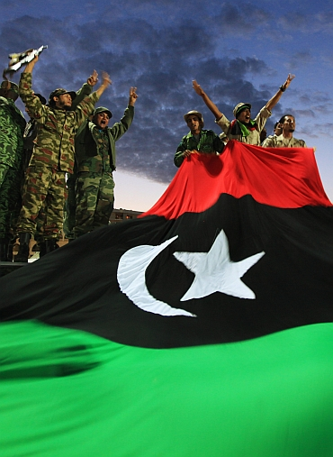 Anti-Gaddafi fighters celebrate Gaddafi's fall