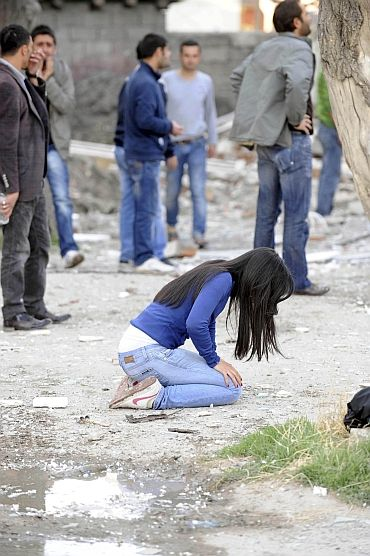 Survivors react following an earthquake in Tabanli village near the eastern Turkish city of Van