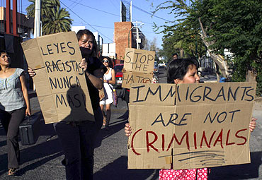 People protest against the crackdown on illegal immigrants