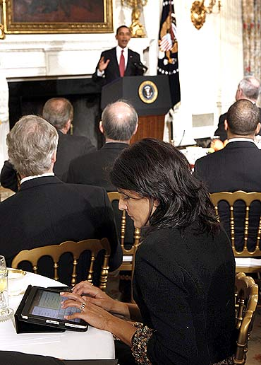 Nikki Haley types on her iPad as US President Barack Obama speaks during a meeting with a bipartisan group of governors in the State Dining Room at the White House in Washington