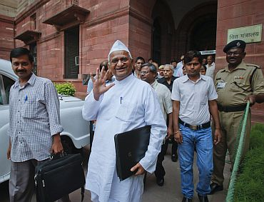 File picture of Anna Hazare and his associates coming out of the finance ministry building after a meeting of the joint drafting com