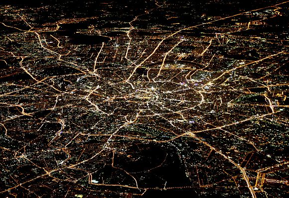 A general view of night Moscow is seen from the window of a passenger jet