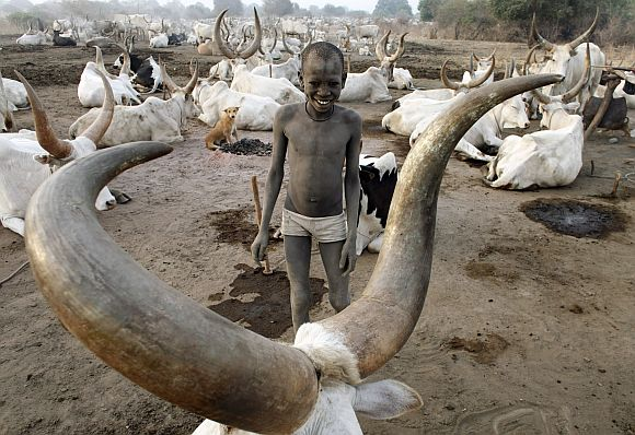 A boy from the cattle herding Mundari tribe smiles early morning in a settlement near Terekeka, Central Equatoria state, south Sudan