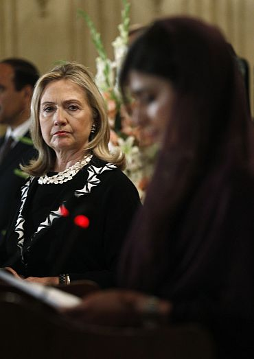 US Secretary of State Hillary Clinton listens to Pakistan's Foreign Minister Hina Rabbani Khar speak during a joint press availability in Islamabad on October 21.
