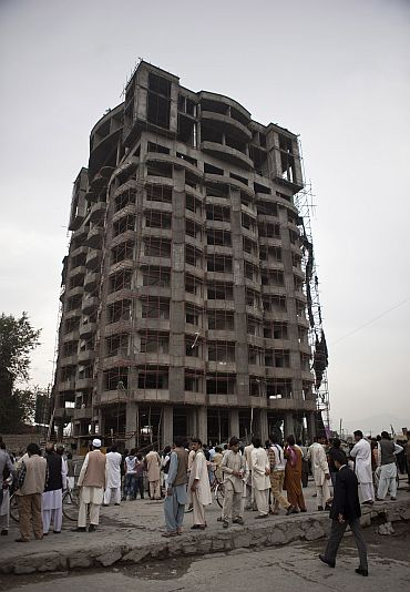 Afghans at a building recaptured from Taliban terrorists in Kabul, September 14.
