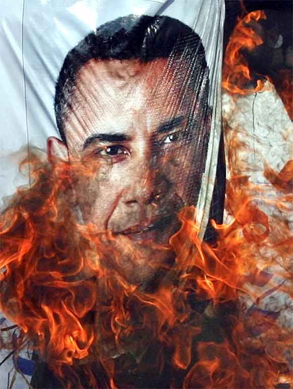 Supporters of the religious political party Sunni Tehreek set ablaze an effigy of U.S. President Barack Obama during an anti-American rally in Hyderabad