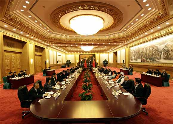 Pakistan's Prime Minister Yusuf Raza Gilani and China's Premier Wen Jiabao attend a meeting at the Great Hall of the People in Beijing