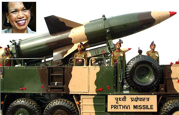 Indian soldiers stand beside a surface-to-surface missile, the Prithvi. Inset: Former top American diplomat Condoleezza Rice