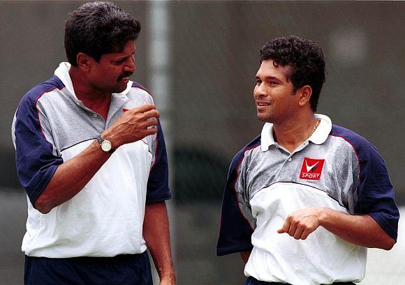 A file photo of  Kapil Dev and Sachin Tendulkar