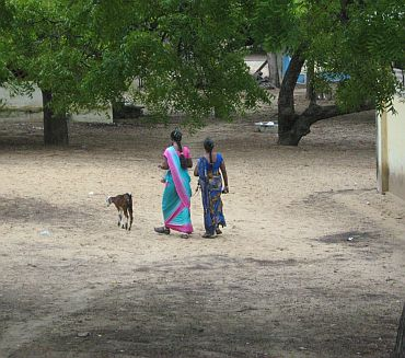 Two Lankan refugees walk inside the Mandapam camp in Ramnathapuram