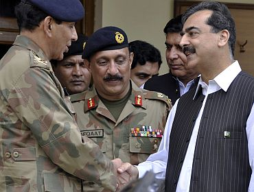 File picture of Pakistan Prime Minister Gilani shaking hands with army chief General
