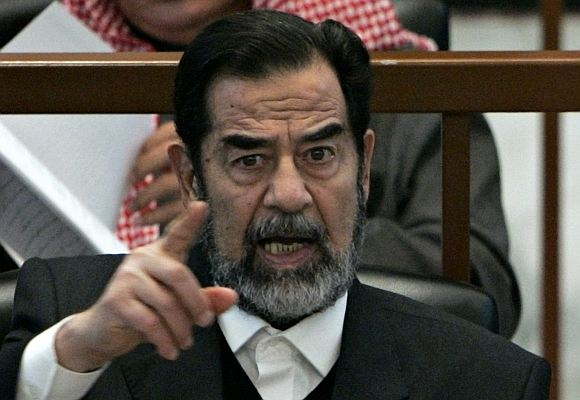 Late Iraqi President Saddam Hussein reacts in court during the Anfal genocide trial in Baghdad in this picture taken on December 21, 2006.