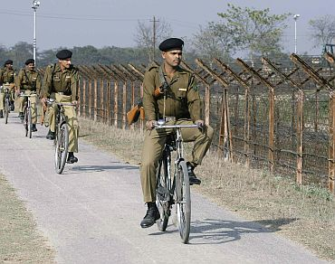 BSF personnel along the fenced border with Bangladesh in Fasidaya village on the outskirts of Siliguri