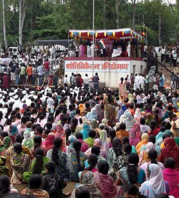 Anna Hazare speaks to villagers at a 'gramsabha' in Ralegan Siddhi