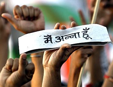 Supporters of Anna Hazare protest at Ramlila Ground in New Delhi