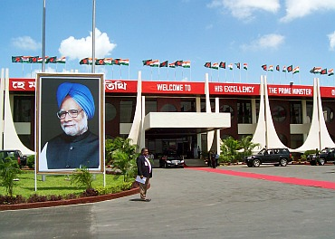 Giant posters of Dr Singh and Sheikh Hasina at the Hazrat Shahjalal airport