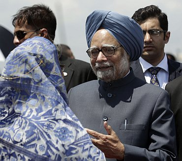 Bangladesh's PM Hasina greets Dr Manmohan Singh and his wife Gursharan Kaur.