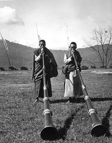 Tibetan monks playing long trumpets at the Festival of Kanchenjunga in Tibet in this April, 1959 picture