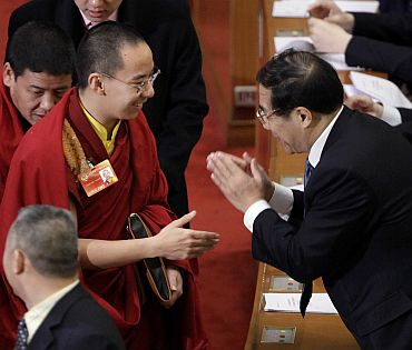 Gyaltsen Norbu, the Panchen Lama, is greeted by a Chinese delegate in at a function in Beijing