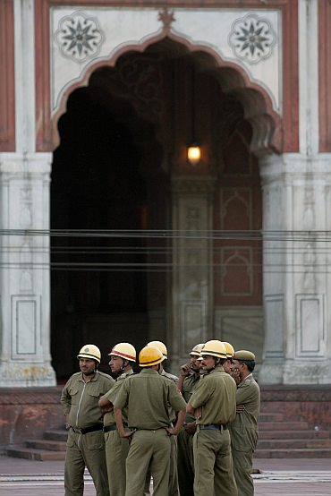 Police officers stand guard inside Jama Masjid after the  blast