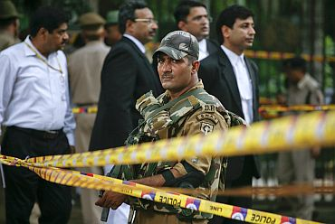 A Delhi police personnel keeps vigil after cordoning off the site of the blast