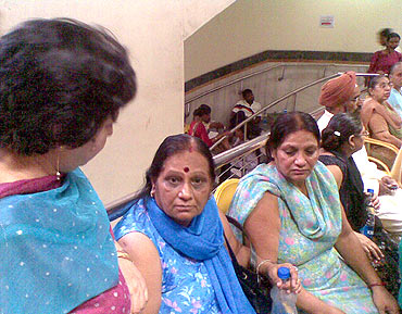 Neeru Mahindra (right) waits outside the operation theatre at the RML hospital