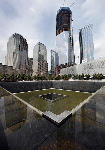 The south pool waterfall is tested as work continues on the National September 11 Memorial and Museum at the World Trade Center site in New York